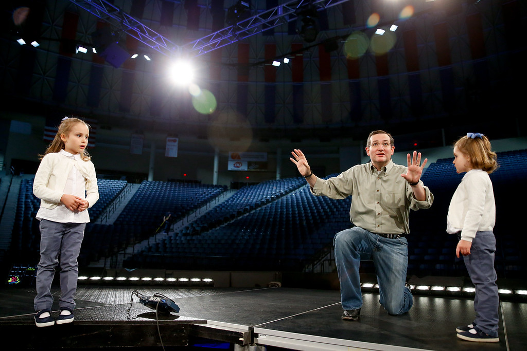 . Sen. Ted Cruz, R-Texas, brings his daughters, Catherine, 4, right, and Caroline, 6, left, on stage during a walk-through, to tell them what to expect for Cruz\'s Monday morning speech where he is expected to launch his campaign for U.S. president, at Liberty University, Sunday, March 22, 2015, in Lynchburg, Va. Cruz will be the first major candidate in the 2016 race for president. (AP Photo/Andrew Harnik)