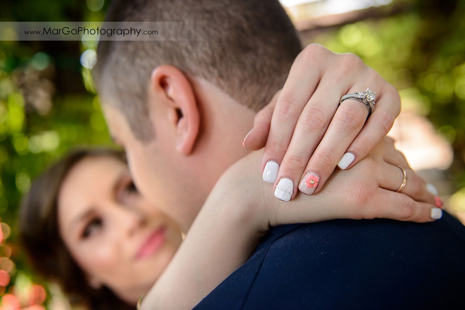 ring shoot of bride keeping hands on groom's neck at Saratoga Foothill Club
