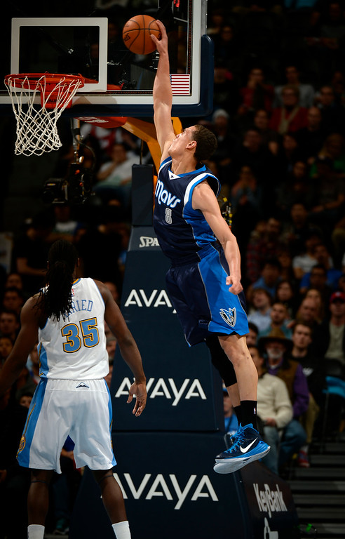 . DENVER, CO - JANUARY 14: Dallas Mavericks forward Dwight Powell (8) goes up for a dunk as Denver Nuggets forward Kenneth Faried (35) looks on during the second quarter January 14, 2015 at Pepsi Center. (Photo By John Leyba/The Denver Post)