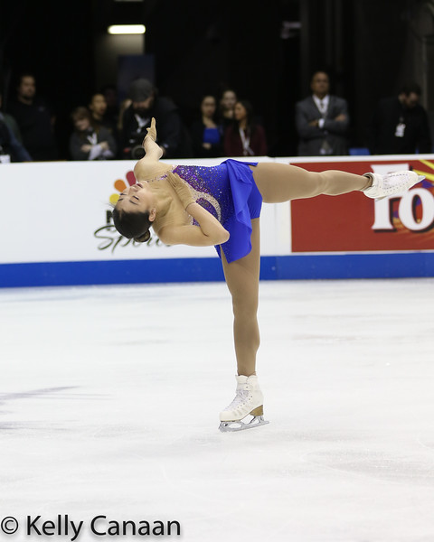 Mirai Nagasu performs a spin during her free skate in Kansas City.