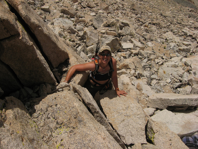 Lauras turn to scramble up to the summit
