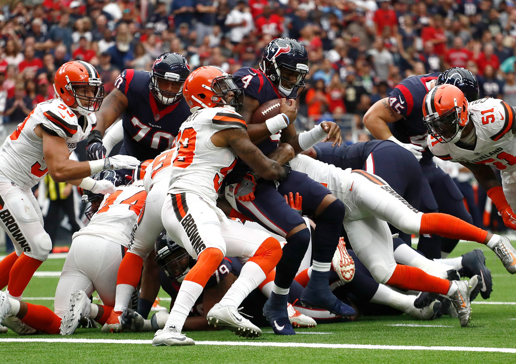 . Cleveland Browns linebacker Christian Kirksey (58) stops Houston Texans quarterback Deshaun Watson (4) from reaching the end zone on a carry in the first half of an NFL football game, Sunday, Oct. 15, 2017, in Houston. (AP Photo/Eric Gay)