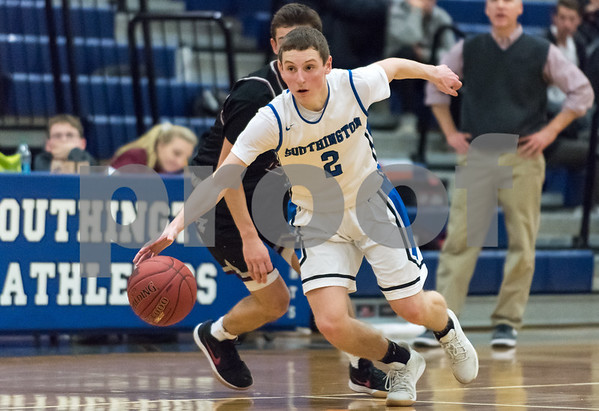 12/21/17 Wesley Bunnell | Staff Southington basketball defeated Farmington on Thursday night at Southington High School. Ryan Gesualdo (2).