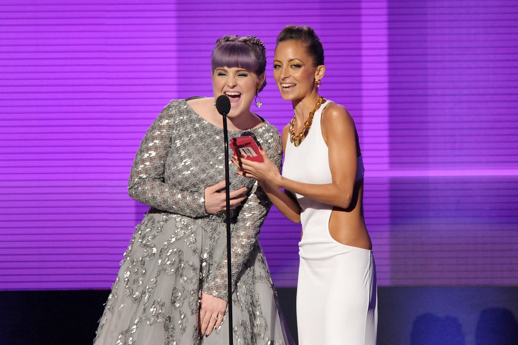 . Kelly Osbourne, left, and Nicole Richie present the award for favorite album - pop/rock at the American Music Awards at the Nokia Theatre L.A. Live on Sunday, Nov. 24, 2013, in Los Angeles. (Photo by John Shearer/Invision/AP)