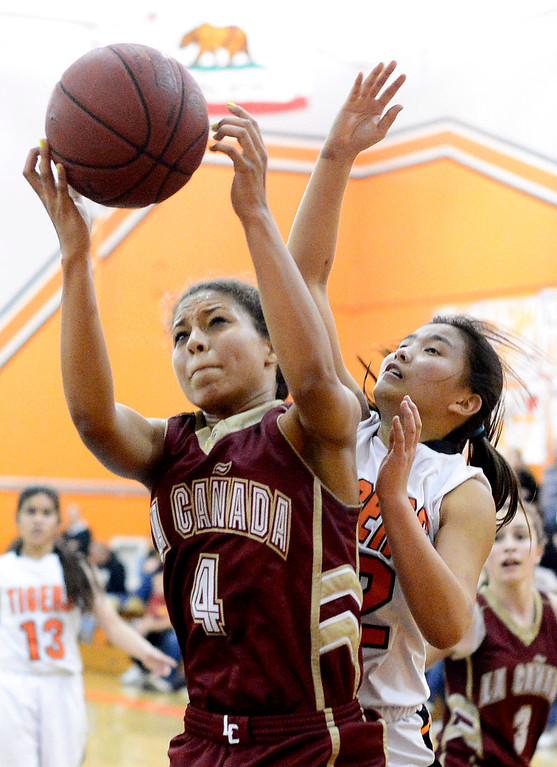 . La Canada\'s Marie Weston (4) gets a rebound during South Pasadena\'s 66-58 win Friday night, January 31, 2014 at South Pasadena High School. (Photo by Sarah Reingewirtz/Pasadena Star-News)