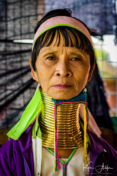 Meeting members of the Padaung ethnic minority, whose women are famous for wearing heavy brass coils to make their necks look longer.
