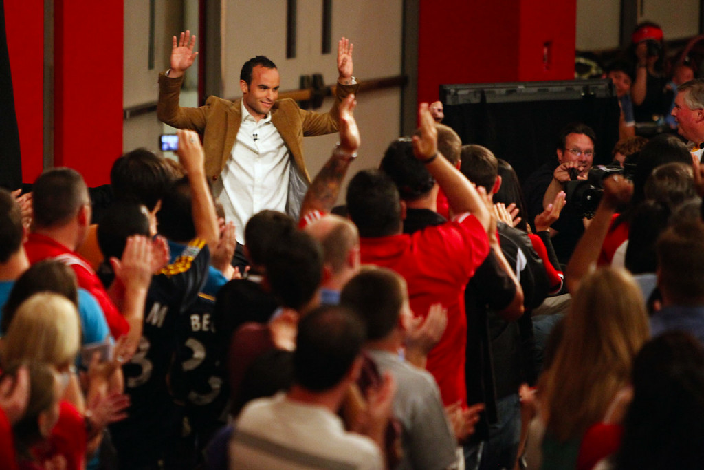 """. Landon Donovan waves to students at Redlands East Valley High School, where he was a student, during the taping of a segment for the ESPN show \""""Home Coming with Rick Reilly\"""" in Redlands Monday, April 19, 2010. Donovan, now a professional soccer player with the Los Angeles Galaxy, was a paper boy for the Redlands Daily Facts when he was a young teenager. (Staff file photo/Redlands Daily Facts)"""