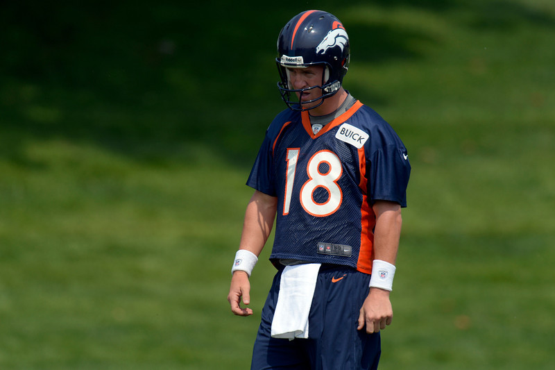 . Peyton Manning (18) QB of the Denver Broncos looks on during drills on the last day of  minicamp June 13, 2013 at Dove Valley. (Photo By John Leyba/The Denver Post)