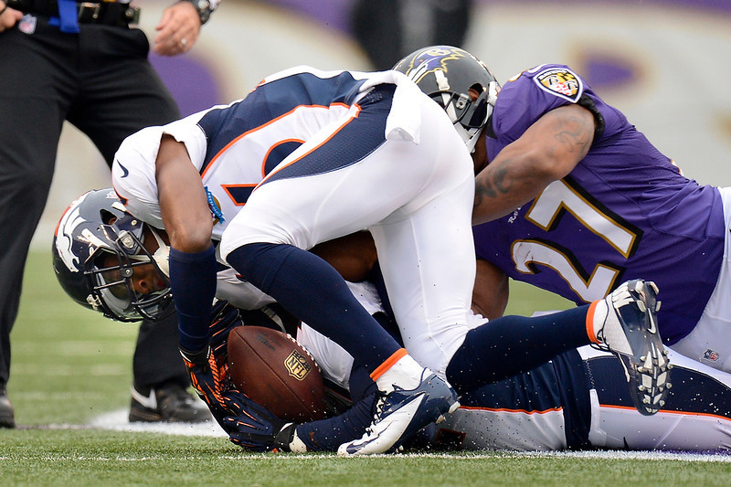 . Denver Broncos free safety Rahim Moore #26 recovers a fumble against the Baltimore Ravens at the M&T Bank Stadium, in Baltimore , MD Sunday December 16, 2012.      Joe Amon, The Denver Post