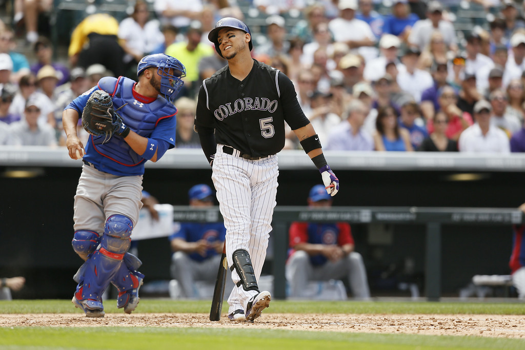. Colorado Rockies right fielder Carlos Gonzalez #5 reacts in disappointment after striking out against the Chicago Cubs at Coors Field on August 7, 2014 in Denver, Colorado.  The Chicago Cubs defeated the Colorado Rockies 6-2.  (Photo by Trevor Brown, Jr./Getty Images)