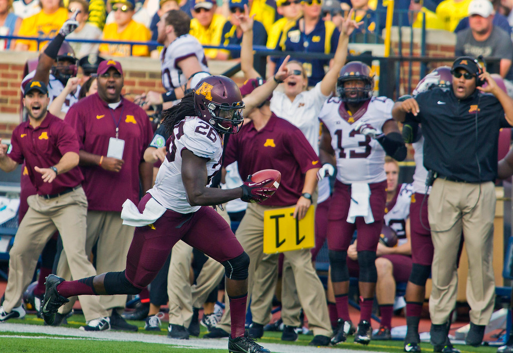 . Minnesota linebacker De\'Vondre Campbell (26) rushes for a touchdown after intercepting a Michigan pass in the third quarter of an NCAA college football game in Ann Arbor, Mich., Saturday, Sept. 27, 2014. Minnesota won 30-14. (AP Photo/Tony Ding)
