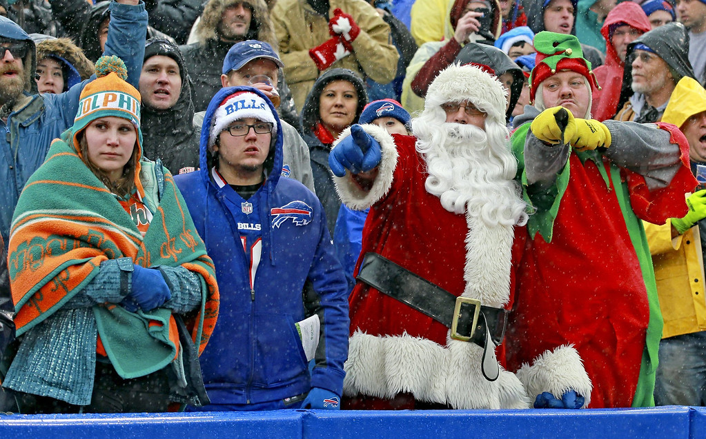 . Miami Dolphins and Buffalo Bills fand watch the game in the cold rain, as Santa and his elf react to a play, at Ralph Wilson Stadium in Buffalo, Sunday, Dec. 22, 2013. The Bills defeated the Dolphins, 19-0. (Charles Trainor Jr./Miami Herald/MCT)