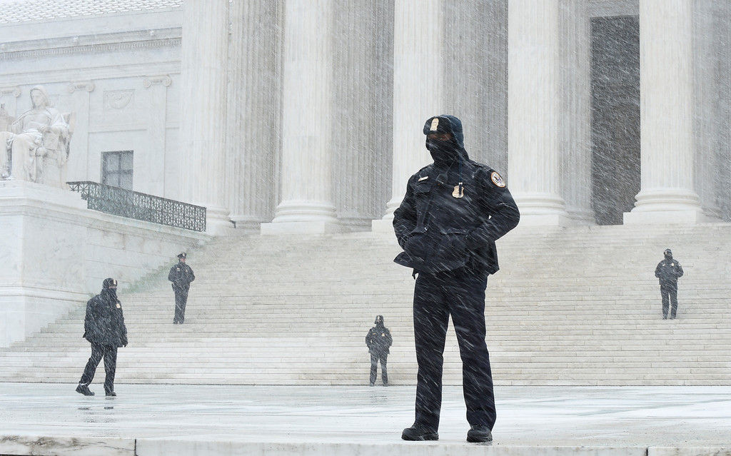 . Officers stand outside the Supreme Court in Washington, Friday, Jan. 22, 2016, during the March for Life 2016, the annual rally on the anniversary of 1973 \'Roe v. Wade\' U.S. Supreme Court decision legalizing abortion. (AP Photo/Susan Walsh)