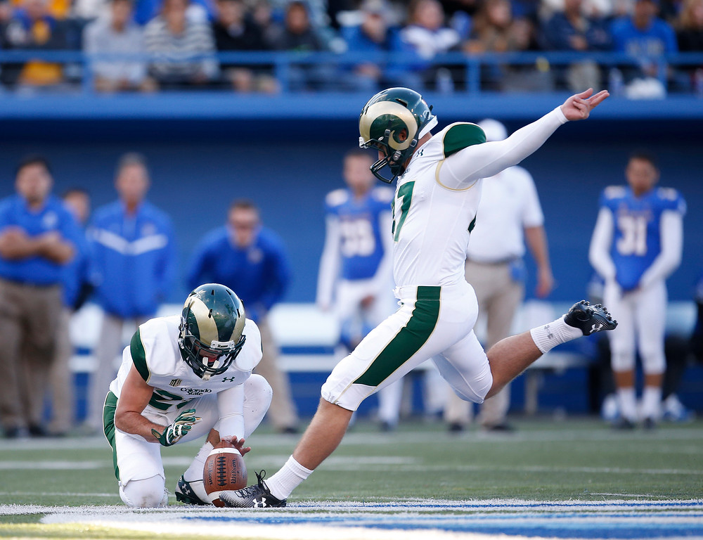 . Colorado State place kicker Jared Roberts (47) boots a 53-yard field goal with Joe Hansley holding against San Jose State during the first half of an NCAA college football game Saturday, Nov. 1, 2014, in San Jose, Calif. (AP Photo/Tony Avelar)