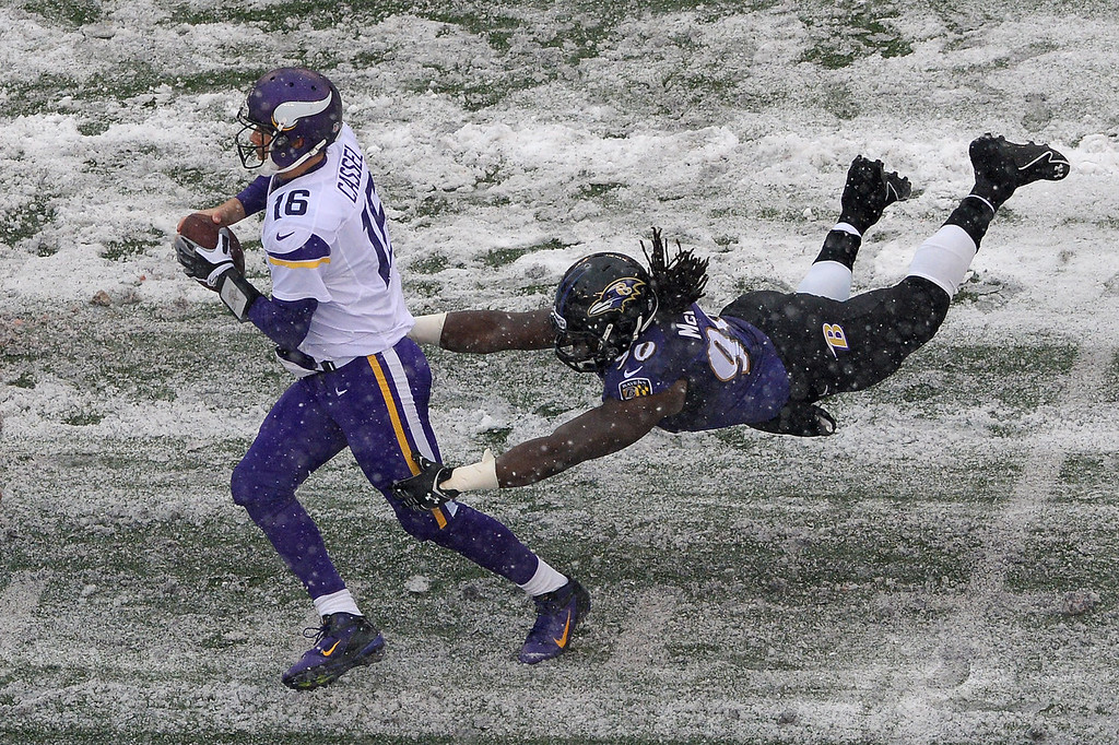 . Quarterback Matt Cassel #16 of the Minnesota Vikings avoids being sacked by linebacker Pernell McPhee #90 of the Baltimore Ravens in the second quarter at M&T Bank Stadium on December 8, 2013 in Baltimore, Maryland. (Photo by Patrick Smith/Getty Images)