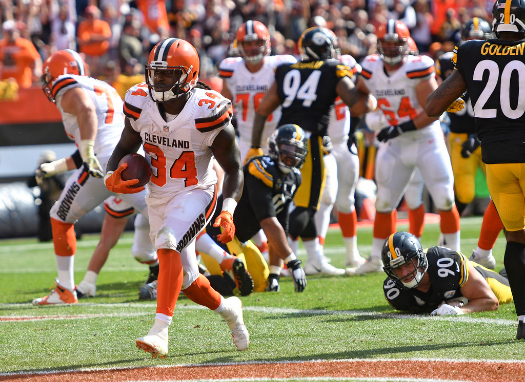 . Cleveland Browns running back Isaiah Crowell (34) runs in the end zone for a two-point conversion during the second half of an NFL football game against the Pittsburgh Steelers, Sunday, Sept. 10, 2017, in Cleveland. (AP Photo/David Richard)