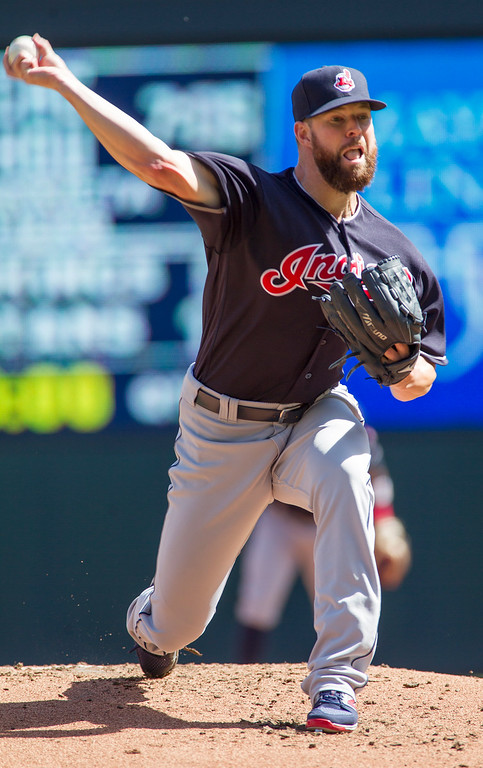 . Cleveland Indians starting pitcher Corey Kluber delivers against the Minnesota Twins during the first inning of a baseball game, Sunday, Sept. 11, 2016, in Minneapolis. (AP Photo/Paul Battaglia)