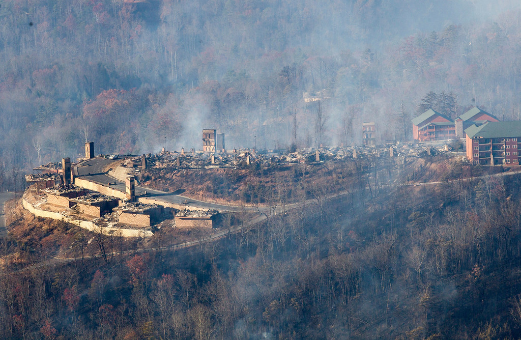 . Burned structures are seen from aboard a National Guard helicopter near Gatlinburg, Tenn., Tuesday, Nov. 29, 2016. Thousands of people raced through a hell-like landscape to escape wildfires that killed several people and destroyed hundreds of homes in the Great Smoky Mountains. (AP Photo/Erik Schelzig)