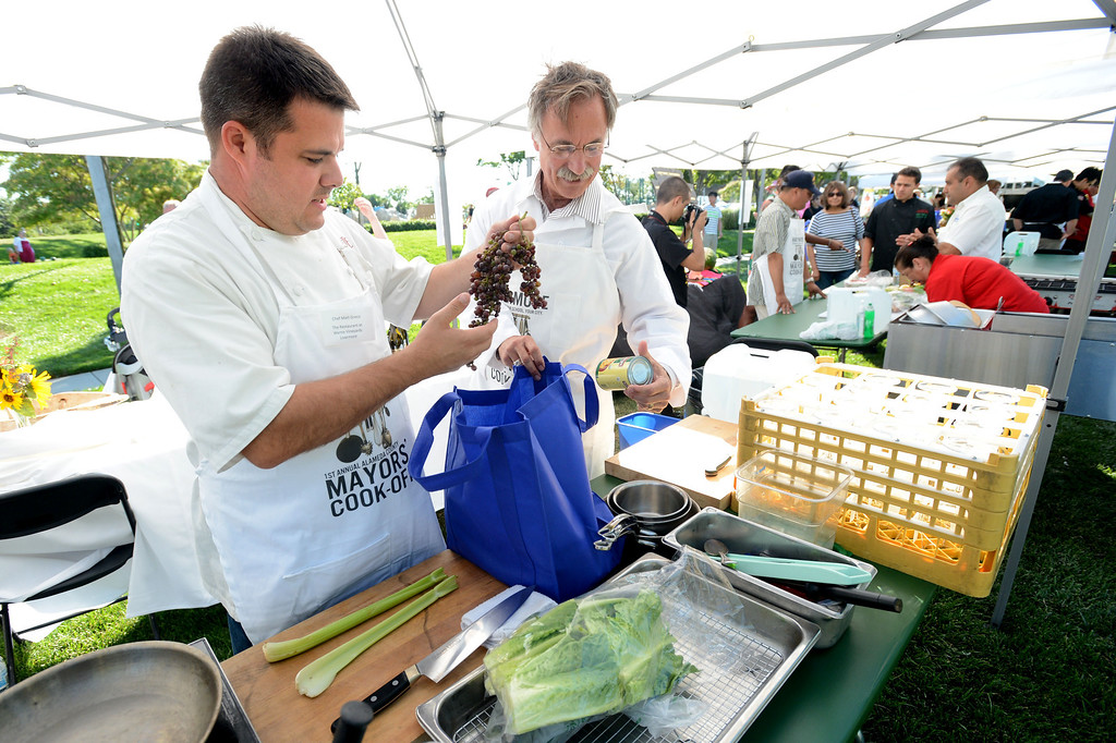 ". Matt Greco, the Chef at Livermore\'s Wente Vineyards restaurant, left, and Livermore Mayor John Marchand, look through the cooking ingredients given to them during the ""Alameda County Mayors\' Healthy Cook-Off Challenge\"" held at the Dublin Farmers\' Market at Emerald Glen Park in Dublin, Calif., on Thursday, July 25, 2013. The Livermore team went on to take first place advancing them to compete against the winners of the Contra Cost County Mayors\' Healthy Cook-Off Challenge. The contest will be held at Mt. Diablo High School in the fall. The cook-off was presented by Concord\'s Wellness City Challenge and promotes the importance of healthy eating. (Doug Duran/Bay Area News Group)"