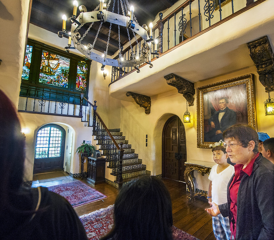""". Carol Hamilton giving a tour through  La Casa Nueva, or \""""the new house.\"""" Built between 1922 and 1927, this 12,400-square-foot Spanish Colonial Revival mansion is noted for its fine architectural crafts, including stained glass, ceramic tile, wrought iron, and carved wood. La Casa Nueva, or \""""the new house.\"""" The Homestead Museum will honor seven of its volunteers, all local La Puente and Hacienda Heights residents, at its annual Volunteer Appreciation Dinner on Sat., April 6. The volunteers have given more than 4,700 hours of their time to the museum giving tours of the historic homes and properties as well as during the museum\'s festivals, workshops, youth programs and more. The volunteers to be honored are well trained docents with several years of experience. Carol Hamilton (1,000 hrs) and Eldon Dunn (6,000 hrs) of Hacienda Heights. (SGVN/Photo by Walt Mancini/Highlanders)"""
