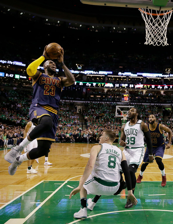 . Cleveland Cavaliers forward LeBron James (23) drives to the basket against Boston Celtics forwards Jonas Jerebko (8) and Jae Crowder (99) during the first half of Game 5 of the NBA basketball Eastern Conference finals, on Thursday, May 25, 2017, in Boston. (AP Photo/Charles Krupa)