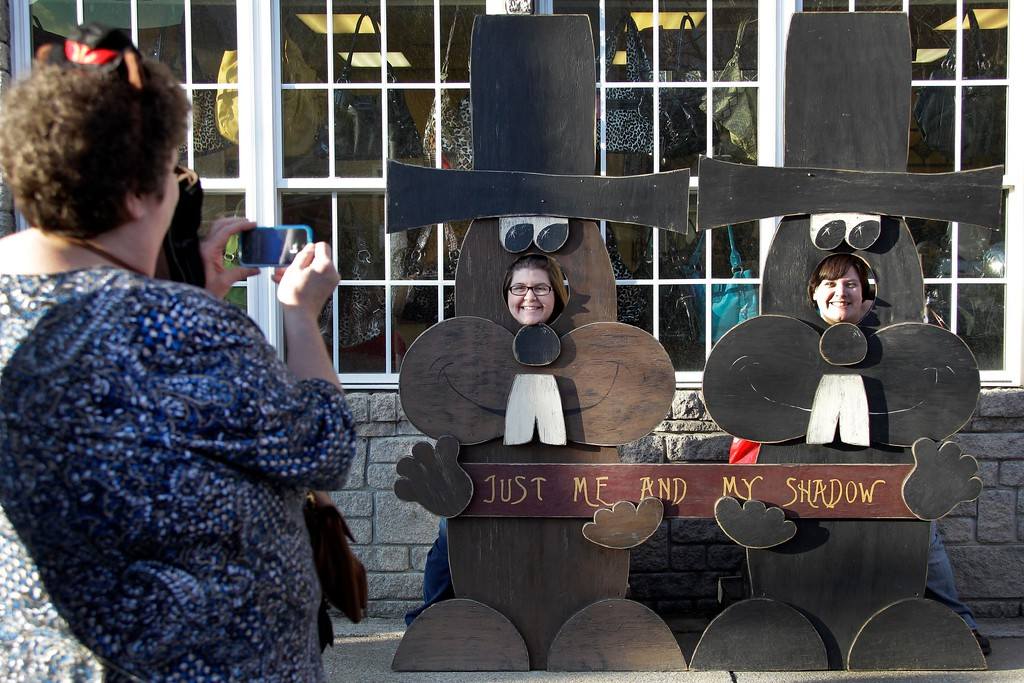 . Shannon and Meagan Clark, of Utica, Pa., have their picture taken posing in a cutout of Punxsutawney Phil in downtown Punxsutawney, Pa., Wednesday, Feb. 1, 2012. The two were in town to celebrate their mother\'s birthday, with their mother, on Gobbler\'s Knob on Groundhog Day. (AP Photo/Gene J. Puskar)