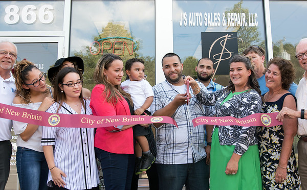 08/29/18 Wesley Bunnell | Staff J's Auto Sales and Repair LLC located at 866 West Main St in New Britain held a ribbon cutting for their official opening on Wednesday afternoon. Economic Development Director Bill Carroll, L, Ilyzia Cardona, Jazmarie Ruiz, Minerva Cardona, Jace Ruiz, age 2, Jesus Ruiz, Mayor Erin Stewart, property owner representative Lorraine Mattison and Alderman Don Naples.