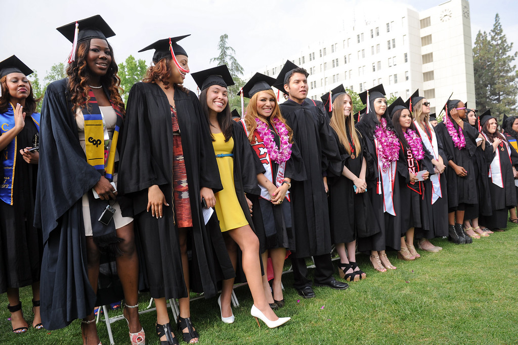. Graduates stand for the national anthem at the CSUN commencement ceremony, Tuesday, May 21, 2013. (Michael Owen Baker/L.A. Daily News)