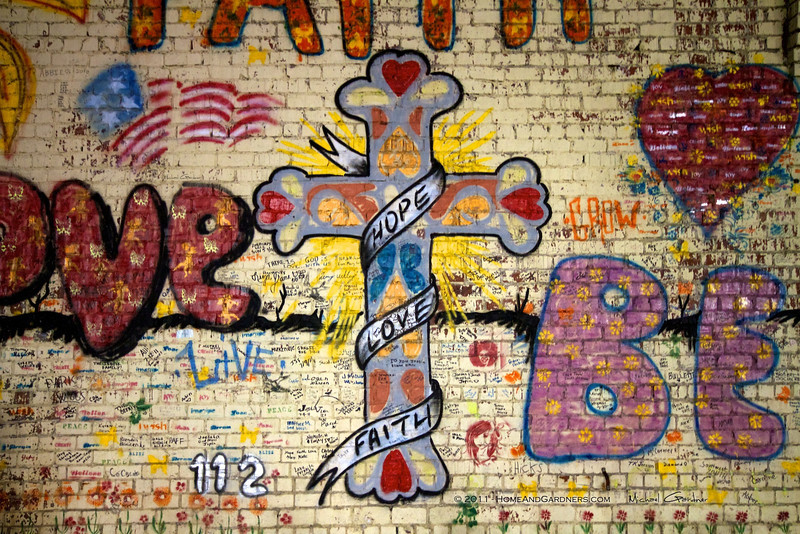 """This inspiring mural with 8' tall cross """"Hope Love & Faith"""" was painted on a gas station wall after the Joplin Tornado."""