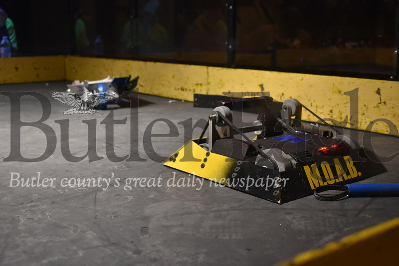 Pine-Richland High School's robot M.O.A.B battles Butler Senior High School's robot Absolute Zero during the 14th annual Southwestern Pennsylvania BotsIQ competition. Photos by Gabriella Canales