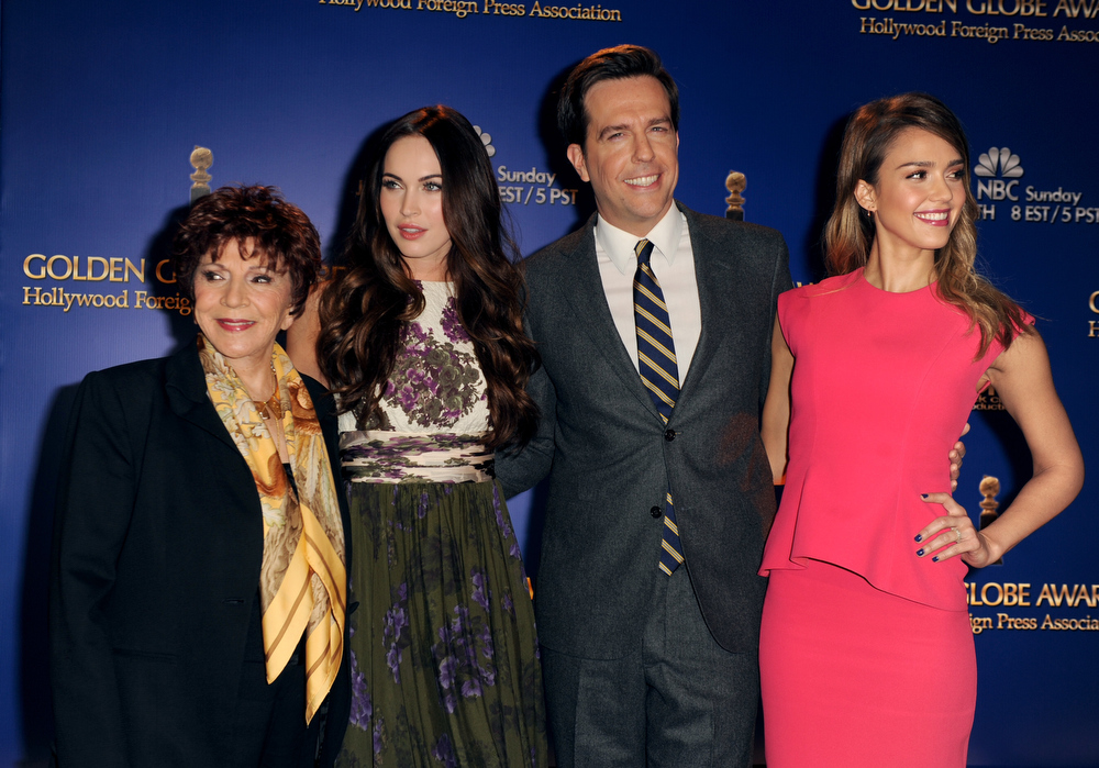 Description of . Hollywood Foreign Press Association (HFPA) President Dr. Aida Takla-O'Reilly, actors Megan Fox, Ed Helms, and Jessica Alba  pose onstage during the 70th Annual Golden Globes Awards Nominations at the Beverly Hilton Hotel on December 13, 2012 in Los Angeles, California.  (Photo by Kevin Winter/Getty Images)