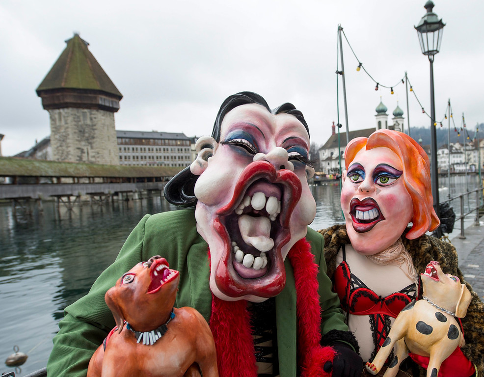 . Carnival participants pose for pictures during the carnival procession (Fasnacht), in the historic center of Lucerne, Switzerland, 27 February 2014.  EPA/SIGI TISCHLER