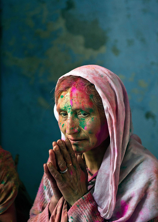 . An Indian widow, seen smeared with coloured powder, rests after celebrating Holi in Vrindavan on March 14, 2014. Breaking centuries-old tradition, around 1,000 widows living in the holy city of Vrindavan celebrated the spring colour festival of Holi at Meera Sahabhagini Sadan in Vrindavan. In a symbolic gesture, the widows celebrated Holi with colors and gulal unlike the previous year where they only sprinkled flower petals over each other. As per Indian tradition, widows are considered social outcasts and refrain from celebrating Holi.  AFP PHOTO/Prakash SINGH/AFP/Getty Images