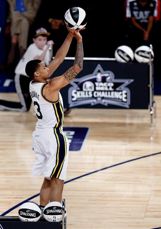 . Trey Burke of the Utah Jazz  participates in the Skills Challenge portion of the NBA All-Star Saturday Night festivities in New Orleans, Louisiana, USA, 15 February 2014. Burke and partner Damian Lillard of the Portland Trailblazers won the contest.  EPA/DAN ANDERSON