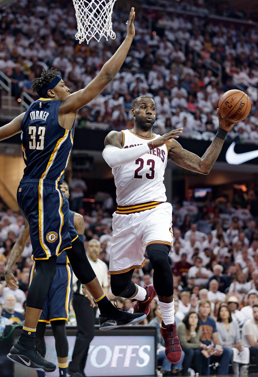 . Cleveland Cavaliers\' LeBron James (23) passes against Indiana Pacers\' Myles Turner (33) in the first half in Game 1 of a first-round NBA basketball playoff series, Saturday, April 15, 2017, in Cleveland. (AP Photo/Tony Dejak)