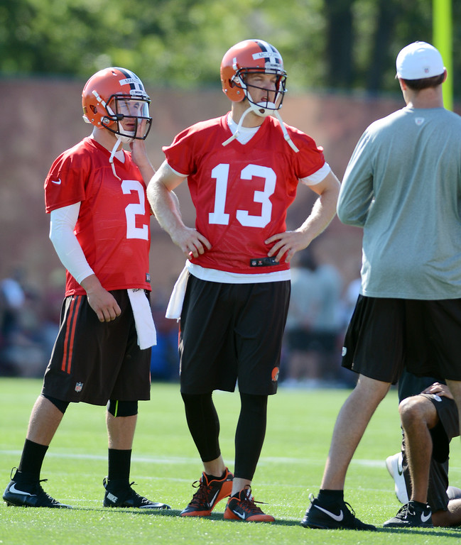 . News-Herald file Quarterbacks Johnny Manziel and Josh McCown watch the action at the opening day of the Cleveland Browns training camp on July 30 in Berea.