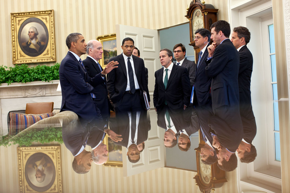 ". July 7, 2011 ""The reflection in this photo (since so many people ask me) was taken with my camera just above a small glass-topped table in the Oval Office as the President talked with members of his staff following a meeting with the Congressional leadership.\""  (Official White House Photo by Pete Souza)"