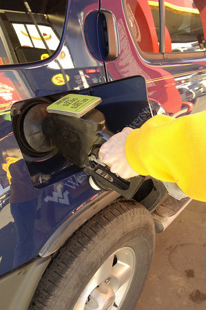 23973 GAS PUMP CLOSE UP SHOTS PUMPING GAS