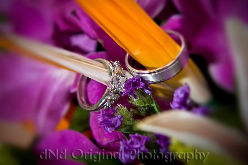 104 Wedding & Dinner - Rings In Bouquet (vig & blur).jpg