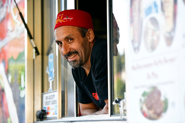 9/19/2019 Mike Orazzi | Staff Sultan Kebab foot truck owner Telat Bozan during the opening night of the Bristol Mum Festival on Memorial Blvd. on Thursday evening.