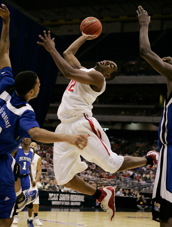 . Ohio State guard Ron Lewis shoots during their  NCAA South Regional final basketball game against Memphis at the Alamodome in San Antonio Saturday, March 24, 2007. Ohio State beat Memphis 92-76.  (AP Photo/David J. Phillip)