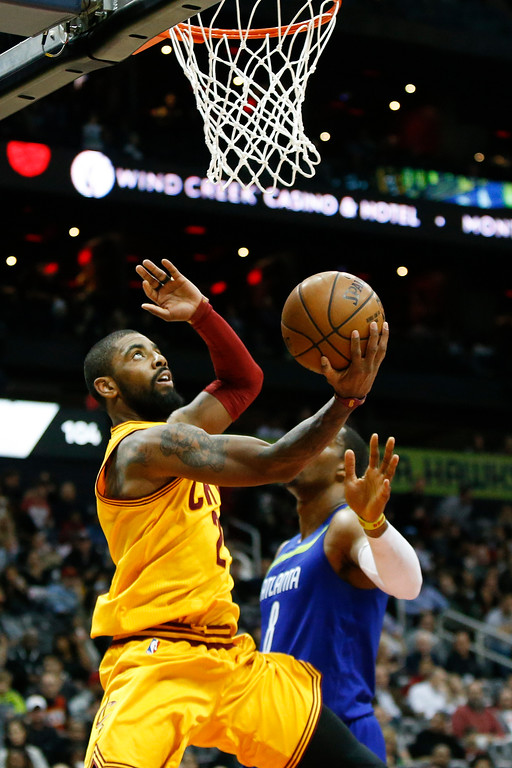. Cleveland Cavaliers guard Kyrie Irving (2) shoots against the Atlanta Hawks in the second half of an NBA basketball game, Friday, March 3, 2017, in Atlanta. The Cavaliers won 135-130. (AP Photo/Brett Davis)