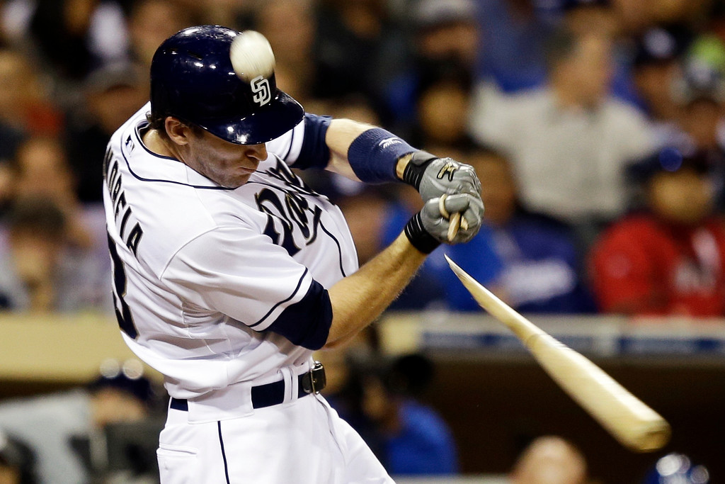 . San Diego Padres\' Chris Denorfia breaks his bat as the ball flies foul during the fourth inning of a baseball game against the Los Angeles Dodgers in San Diego, Wednesday, April 10, 2013. (AP Photo/Lenny Ignelzi)