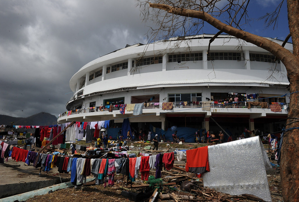 . Clothes are put out to dry outside a stadium used as an evacuation centre in Tacloban, Leyte province, central Philippines on November 10, 2013, three days after devastating Typhoon Haiyan hit the city on November 8.  The death toll from a super typhoon that decimated entire towns in the Philippines could soar well over 10,000, authorities warned on November 10, making it the country\'s worst recorded natural disaster.   TED ALJIBE/AFP/Getty Images
