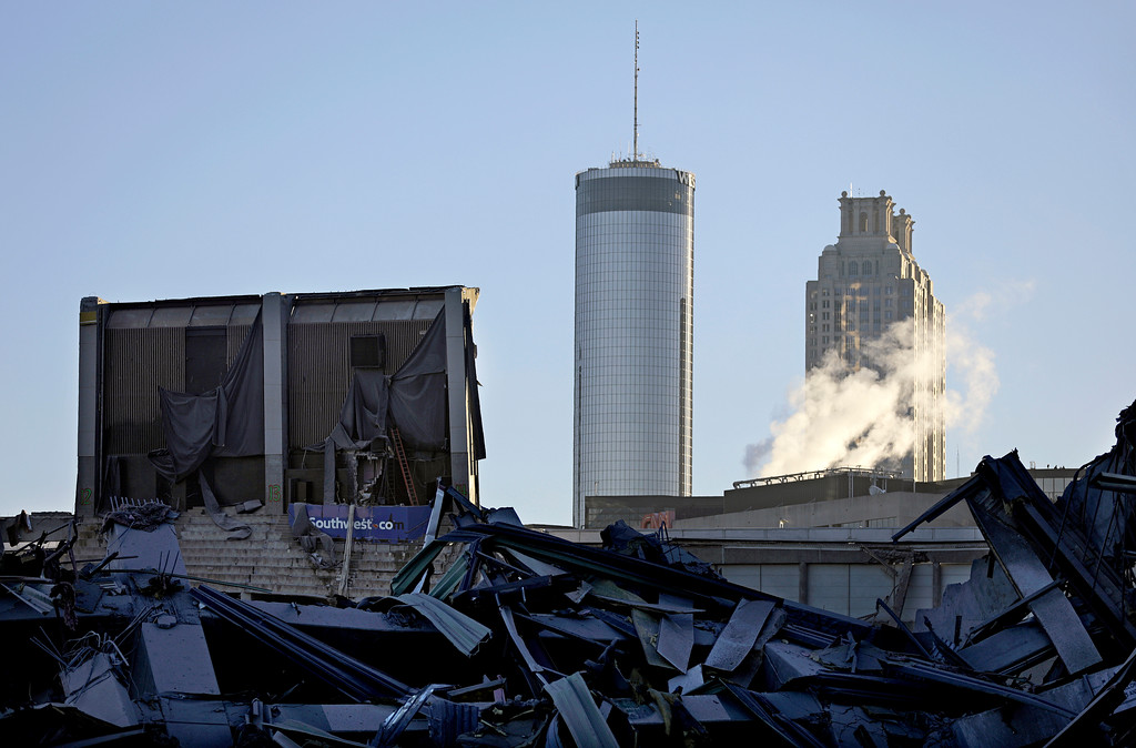 . The upper seats of the Georgia Dome remain standing after the stadium was imploded in Atlanta, Monday, Nov. 20, 2017. The dome was not only the former home of the Atlanta Falcons but also the site of two Super Bowls, 1996 Olympics Games events and NCAA basketball tournaments among other major events. (AP Photo/David Goldman)