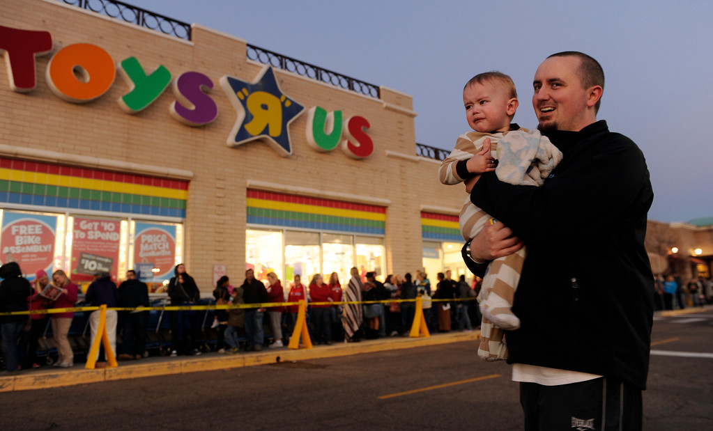 . Michael Curran, age 18-months-old, waited with his father Jon while Michael\'s mother went into buy presents at the Toys R Us store on County Line Road in Arapahoe County Thursday night, November 28, 2013. Many metro area stores got a jump on Black Friday by opening Thanksgiving night. Photo By Karl Gehring/The Denver Post