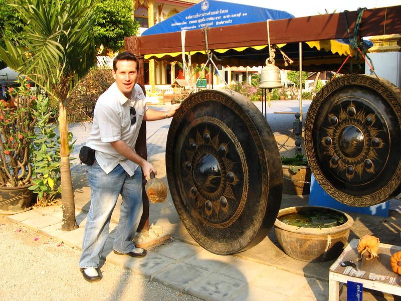 Hitting a gong at Wieng Khum Kham