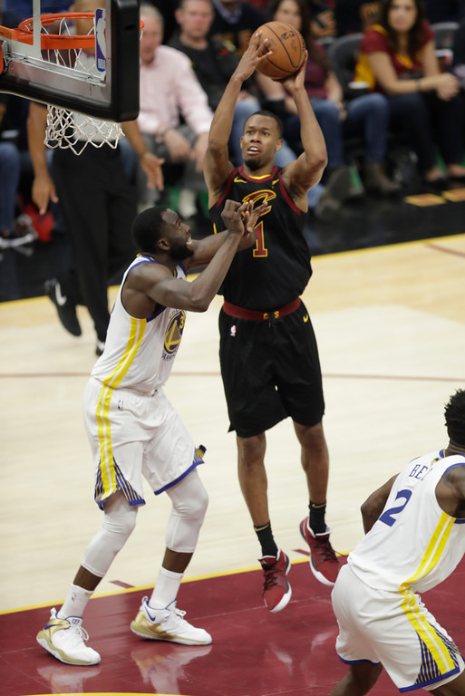 . Cleveland Cavaliers\' Rodney Hood shoots over Golden State Warriors\' Draymond Green in the second half of Game 3 of basketball\'s NBA Finals, Wednesday, June 6, 2018, in Cleveland. (AP Photo/Tony Dejak)