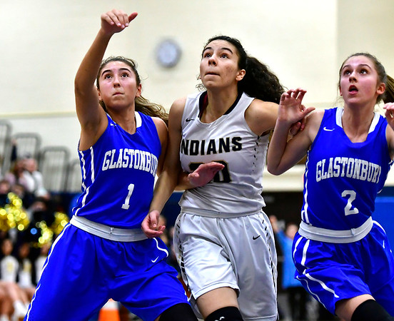 3/1/2019 Mike Orazzi | Staff Newington High School's Olivia St. Remy (20) and Glastonbury's Rachel Roman (1) and Jaci Budaj (2) during the Class LL Second Round of the CIAC 2019 State Girls Basketball Tournament at Newington High School Friday night.