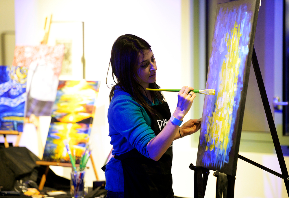 . Sarah Mount of Pinot\'s Palette in the Highlands gets a painting  going before the start of the second annual Westword Whiteout Fashion Show at the McNichols Building in Denver featuring Denver designers on Thursday, January 30, 2014.  (Denver Post Photo by Cyrus McCrimmon)